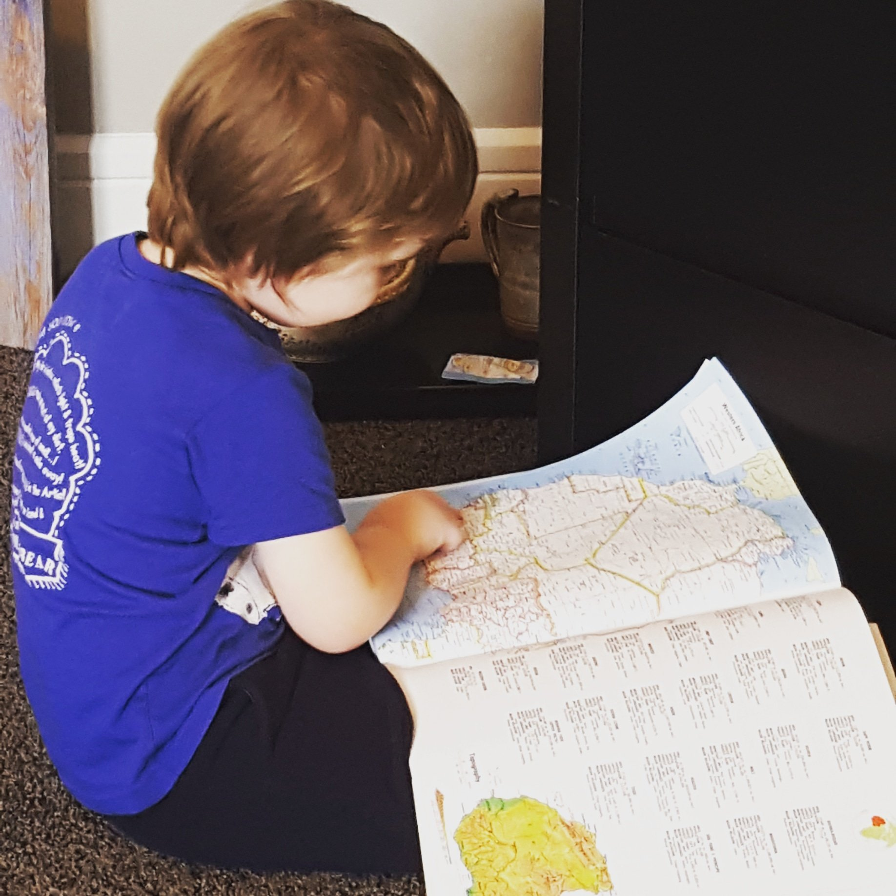 Cub loves atlases as much as I did as a kid, although he started reading them way before I did.